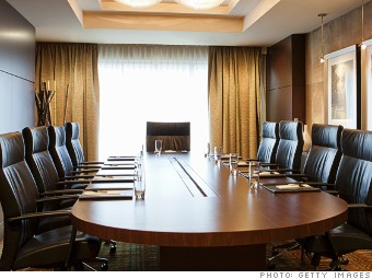 A boardroom is set up for a meeting.